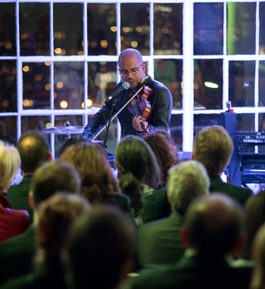Daniel Bernard Roumain plays his violin for the crowd